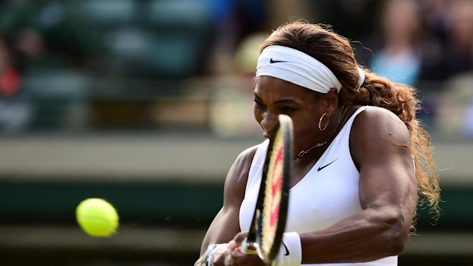 US player Serena Williams returns to France's Alize Cornet during their women's singles third round match on day six of the 2014 Wimbledon Championships at The All England Tennis Club in Wimbledon, on June 28, 2014