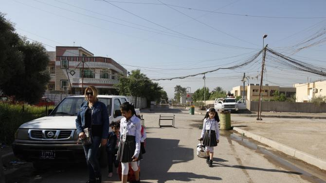 Students walk to class on the first day of the new school term in Baghdad