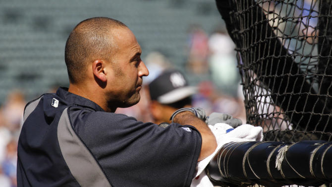 New York Yankees' Derek Jeter waits his turn for batting practice before the Yankees' baseball game against the Texas Rangers, Wednesday July 24, 2013, in Arlington, Texas. (AP Photo/Jim Cowsert)