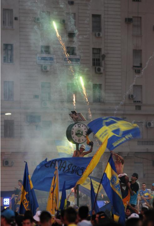 Fans of Argentine soccer team Boca Juniors take part in celebrations of Boca Juniors Fan Day in downtown Buenos Aires