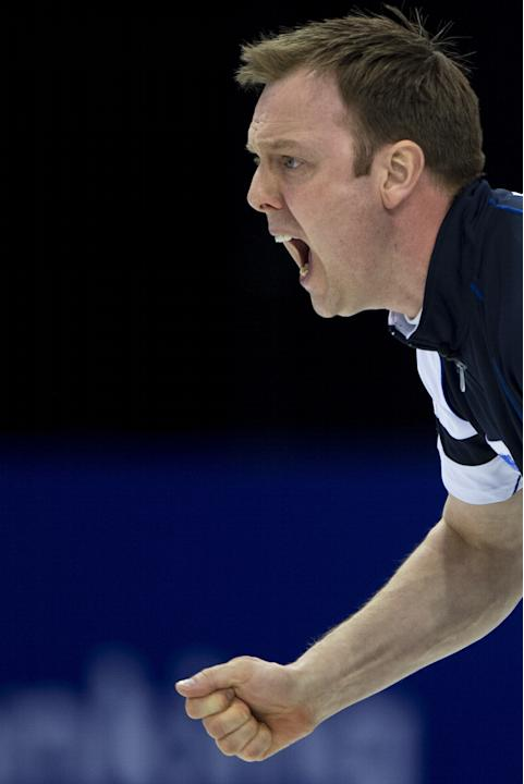 Scotland's skip Tom Brewster reacts on April 8, 2012 during his final match against Canada at the men's World Curling Championship in Basel. AFP PHOTO / FABRICE COFFRINI (Photo credit should read FABR