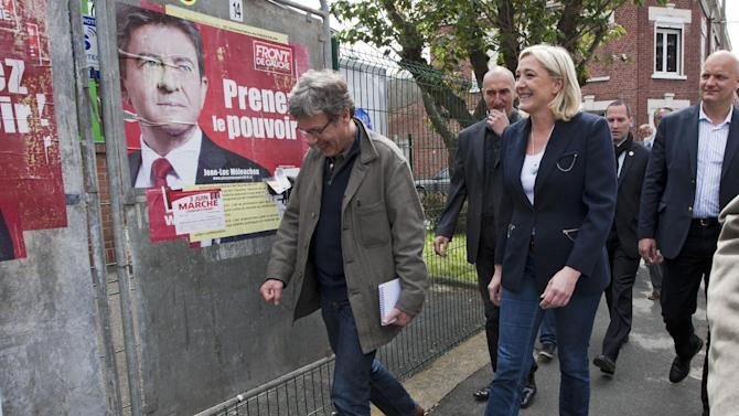 French far-right leader and National Front Party candidate for French legislative elections, for his French  parliament, Marine Le Pen walks after  a voting in  legislative elections, Sunday, June 10, 2012 in Henin-Beaumont, northern France. French Legislative elections will take place next June 10 and 17, and will determine the makeup of the new parliament. (AP Photo/Jacques Brinon)