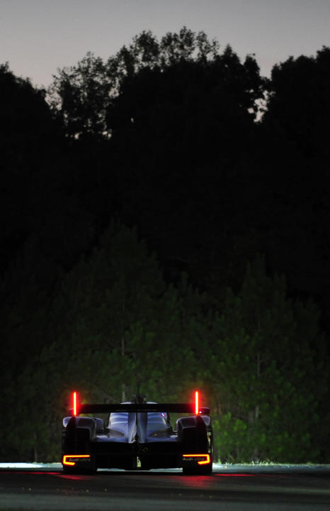 Romain Dumas, of France, goes through a corner in an Audi during night practice for the American Le Mans Series' Petit Le Mans auto race at Road Atlanta, Thursday, Sept. 29, 2011, in Braselton, Ga.  (