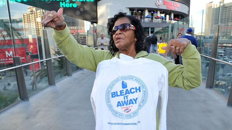 A Las Vegas visitor interacts with the Clorox's Bleach It Away program on the Las Vegas Strip Tuesday, February, 12, 2013 in Las Vegas. (Jeff Bottari / AP Images for Clorox)