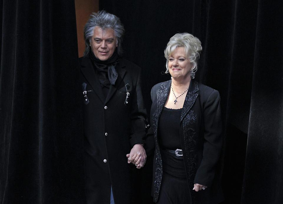 "Connie Smith is escorted by her husband, singer Marty Stuart, to the podium during the announcement on Tuesday, March 6, 2012, that Smith will be inducted into the Country Music Hall of Fame in Nashville, Tenn. Smith, Garth Brooks, and Hargus ""Pig"" Robbins will become the newest members. (AP Photo/Mark Humphrey)"