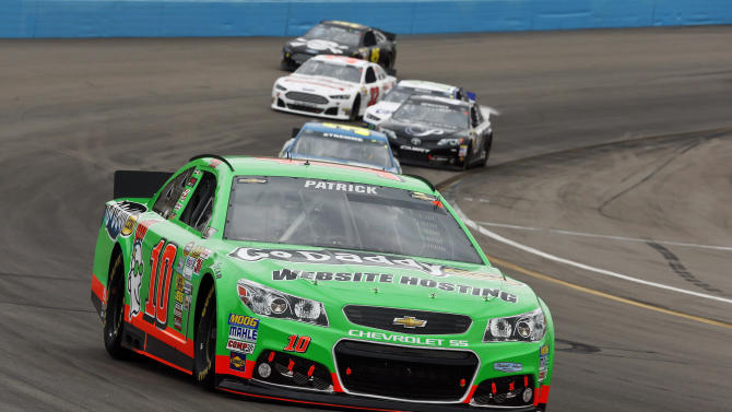 Danica Patrick (10) leads a group of cars out of Turn 4 during the NASCAR Sprint Cup Series auto race, Sunday, March 3, 2013, in Avondale, Ariz. (AP Photo/Ross D. Franklin)