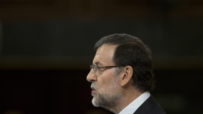 Spain's Prime Minister Mariano Rajoy speaks in the Spanish parliament in Madrid, Wednesday May 8, 2013. Rajoy appeared to explain to Parliament his conservative government's latest round of reforms and its 2013-16 stability program. Unveiling the package recently, the government said it would take two years longer than promised to cut Spain's swollen deficit in an acknowledgement that harsh austerity measures had failed to bring its finances under control. (AP Photo/Paul White)