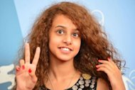 "Actress Waad Mohammed poses during the photocall of ""Wadjda"" at the 69th Venice Film Festival on August 31, 2012 at Venice Lido. The female director of Saudi Arabia's first feature film, showing at the Venice film festival, has explained how she beat the odds to produce the heartwarming tale of a girl's quest to own a bicycle"