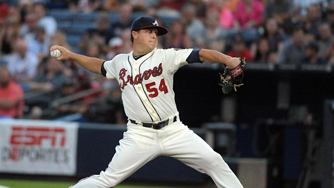Atlanta Braves starting pitcher Kris Medlen delivers to the St. Louis Cardinals during the first inning of a baseball game at Turner Field, Sunday, July 28, 2013, in Atlanta. (AP Photo/David Tulis)