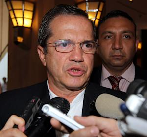 Ecuador's Foreign Mister Ricardo Patino speaks to reporters at a hotel during his visit to Vietnam Monday, June 24, 2013. Patino said that his government is analyzing an asylum request from Edward Snowden, the former National Security Agency contractor wanted for revealing classified secrets. (AP Photo/Tran Van Minh)