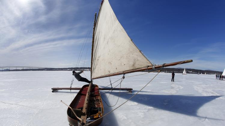 Brett Kolfrat from Cornwall, New York, a member of the Hudson River Ice Yacht Club New York, adjust the shrouds on his ice boat Genevieve, built in 1908, on the frozen Hudson River near, Astor Point in Barrytown, New York