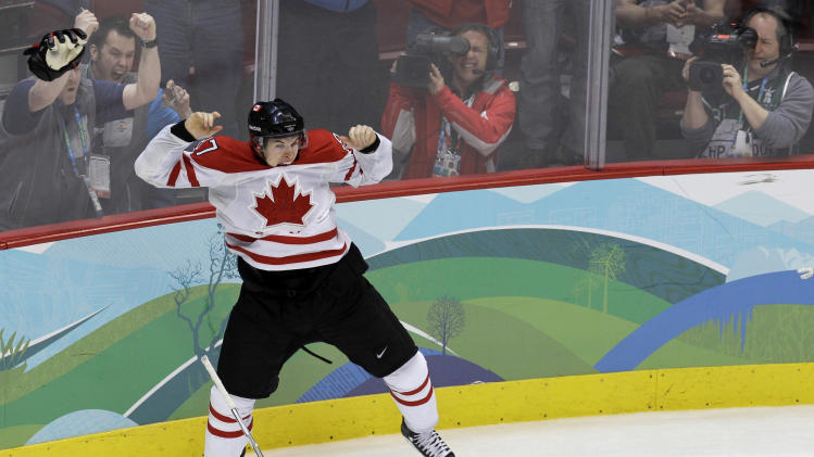 FILE - In this Feb. 28, 2010, file photo, Canada's Sidney Crosby leaps in the air after scoriung the game-winning goal in the overtime period of the men's gold medal ice hockey game against team USA at the Vancouver 2010 Olympics in Vancouver, British Columbia. Hockey Canada announced its 25-man hockey roster, loaded with NHL stars, for the Winter Olympics on Tuesday, Jan. 7, 2014, and Sid the Kid is going to have plenty of help. Joining Crosby, who scored the gold-medal winning goal in 2010 against the U.S., will be Jamie Benn, Patrice Bergeron, Jeff Carter, Matt Duchene, Ryan Getzlaf, Chris Kunitz, Patrick Marleau, Rick Nash, Corey Perry, Patrick Sharp, Steven Stamkos, John Tavares and Jonathan Toews. (AP Photo/Chris O'Meara, File)