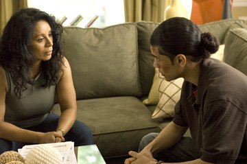 Wanda De Jesus and Rick Gonzalez in Universal Pictures' Illegal Tender