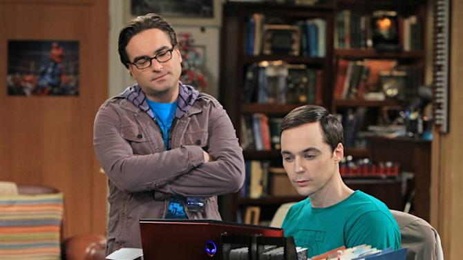 """This image released by CBS shows Johnny Galecki, left, and Jim Parsons in a scene from """"The Big Bang Theory."""" The series was nominated for a Golden Globe for best musical or comedy series on Thursday, Dec. 13, 2012. The 70th annual Golden Globe Awards will be held on Jan. 13.  (AP Photo/CBS, Sonja Flemming)"""