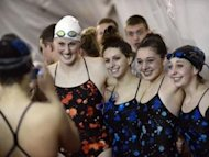 Rival swimmers pose for pictures with Olympic opponent Missy Franklin -- Denver Post