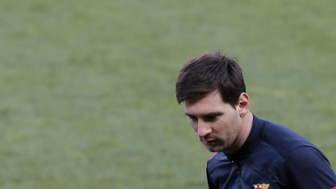 Barcelona's Lionel Messi eyes the ball during a training session in Paris, Monday, April 1, 2013. Barcelona will play against Paris Saint Germain during their Champions League quarterfinal soccer match on Tuesday, April 2, 2013. (AP Photo/Christophe Ena)