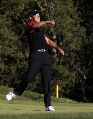 Tiger Woods reacts after winning the Chevron World Challenge golf tournament at Sherwood Country Club, Sunday, Dec. 4, 2011, in Thousand Oaks, Calif. Woods closed with clutch birdie putts, including holing a 6-foot birdie putt on the 18th hole for a 3-under 69, to win by one shot over former Masters champion Zach Johnson. (AP Photo/Danny Moloshok)