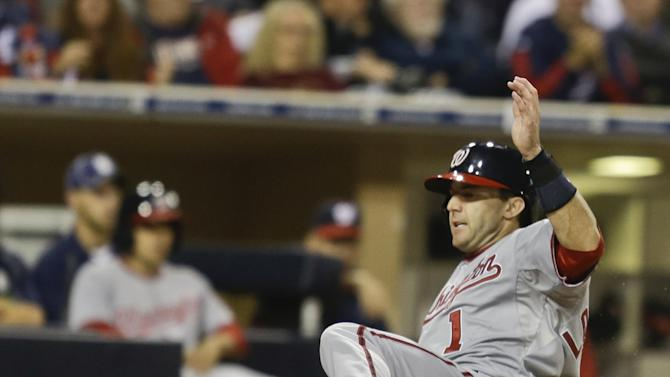 Washington Nationals' Stephen Lombardozzi slides in safely while scoring on a hit by Ryan Zimmerman in the fifth inning of a baseball game in San Diego, Thursday, May 16, 2013. (AP Photo/Lenny Ignelzi)
