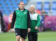 Giovanni Trappatoni (right) wants Richard Dunne to carry on playing
