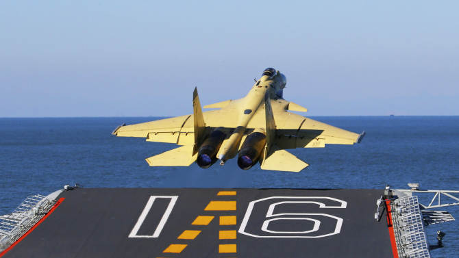 China praises engineer in aircraft carrier program