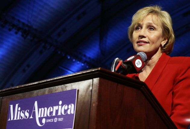 New Jersey Lt. Gov. Kim Guadagno announces that the Miss America pageant is returning to Atlantic City in September after spending six years in Las Vegas, at Atlantic City's Boardwalk Hall Thursday, Feb. 14, 2013, in Atlantic City. (AP Photo/Mel Evans)