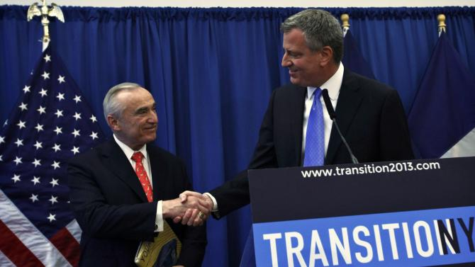 Blasio shakes hands with Bratton during a news conference in Brooklyn