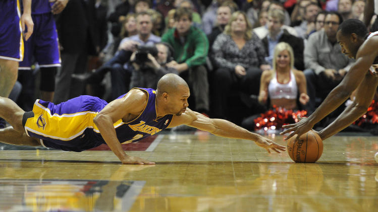 Los Angeles Lakers' Derek Fisher, left, dives for the loose ball as the Milwaukee Bucks' Luc Richard Mbah a Moute grabs it during the first half of an NBA basketball game on Saturday, Jan. 28, 2012, in Milwaukee. (AP Photo/Jim Prisching)