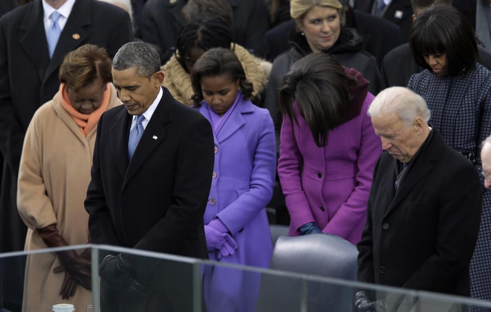 President Barack Obama and Vice President Joe Biden listen to the benediction at the ceremonial swearing-in at the U.S. Capitol during the 57th Presidential Inauguration in Washington, Monday, Jan. 21, 2013. (AP Photo/Carolyn Kaster)