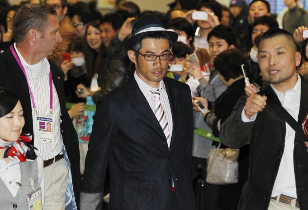 Seattle Mariners outfielder Ichiro Suzuki arrives at Narita International Airport in Narita, east of Tokyo, Friday, March 23, 2012. The Athletics will meet the Seattle Mariners in their two season-opening games of the Major League Baseball in Japan, at Tokyo Dome from Wednesday, March 28. (AP Photo/Koji Sasahara)