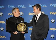 "Actor and director Ben Affleck (R) smiles as he presents Mexican director Alfonso Cuaron with the Feature Film award for ""Gravity"" during the 66th annual Directors Guild of America Awards in Beverly Hills, California January 25, 2014. REUTERS/Gus Ruelas"