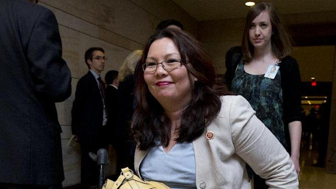 Rep. Tammy Duckworth, D-Ill., leaves a closed all-member briefing on the NSA on Capitol Hill in Washington, Tuesday, June 11, 2013. (AP Photo/Manuel Balce Ceneta)