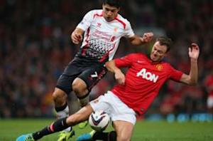 Manchester United is gathering momentum, warns Evans