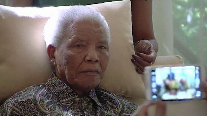 "In this image taken from video, the ailing anti-apartheid icon Nelson Madela is filmed Monday April 29, 2013, more than three weeks after being released from hospital. Mandela was treated in hospital for a recurring lung infection.  South African President Jacob Zuma visited the former leader on Monday, but Mandela does not appear to speak during the televised portion of the visit, as he sits in an armchair, his head propped up by a pillow with his cheeks showing what appear to be marks from a recently removed oxygen mask, although Zuma said he found Nelson Mandela ""in good shape and in good spirits"". (AP Photo/SABC TV) SOUTH AFRICA OUT"