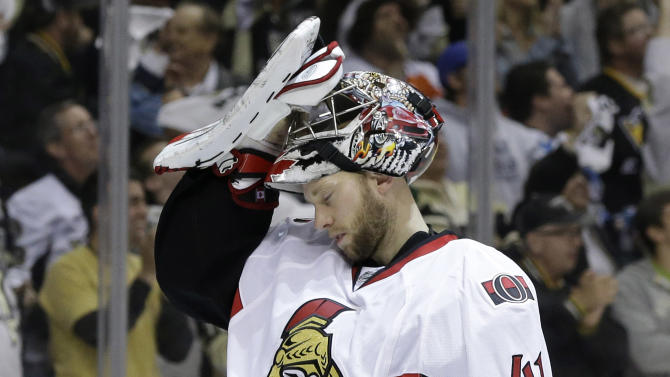 Ottawa Senators goalie Craig Anderson (41) waits for play to resume after allowing a goal to Pittsburgh Penguins' Evgeni Malkin during the second period in Game 5 of the Eastern Conference semifinals in their NHL hockey Stanley Cup playoffs series, Friday, May 24, 2013, in Pittsburgh. The Penguins won 6-2 to advance to the Eastern Conference finals. (AP Photo/Gene J. Puskar)