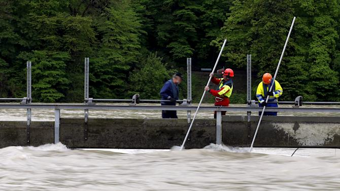 Fire-fighters check the level of the swollen Aare river on a barrage in Bern, Switzerland