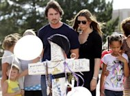 Actor Christian Bale visits the memorial across the street from the Century 16 movie theater in Aurora, Colorado, on July 24. Bale paid a low-key visit to comfort victims of last week&#39;s shooting massacre, which occurred during a screening of his latest film
