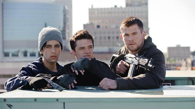 """This film image released by Film District shows Josh Peck , left, Josh Hutcherson, center, and Chris Hemsworth in a scene from """"Red Dawn."""" (AP Photo/Film District)"""
