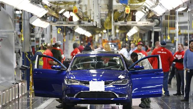 In this March 14, 2014 photo, a 2015 Chrysler 200 automobile moves down the assembly line at the Sterling Heights Assembly Plant in Sterling Heights, Mich. Automakers report sales for May on Tuesday, June 3, 2014. (AP Photo/Paul Sancya)