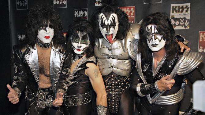 FILE - In this May 8, 2008 file photo, members of Kiss, from left, Paul Stanley, Eric Singer, Gene Simmons and Tommy Thayer, poses for a photograph during a news conference to promote the start of their KISS Alive/35 European Tour in Oberhausen, Germany. Paul Stanley of KISS wants to shout it out loud: The band is miffed at the Rock and Roll Hall of Fame for not inducting members Eric Singer and Tommy Thayer along with the original lineup. KISS is scheduled to be inducted into the Rock Hall of April 10 in New York City. But Stanley said in an interview Friday, March 14, 2014 with The Associated Press that he doesn't think the Rock Hall is being fair and that the organization has altered their rules for other acts. (AP Photo/Volker Wiciok)
