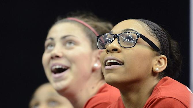 Louisville's Bria Smith, right, and Sara Hammond watch the highlights of their team's run in the women's NCAA Final Four college basketball championship during a ceremony, Wednesday, April 10, 2013, in Louisville, Ky. (AP Photo/Timothy D. Easley)
