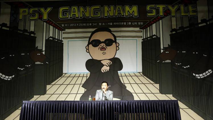 "South Korean rapper PSY, who sings the popular ""Gangnam Style"" song, speaks to the media during a press conference in Seoul, South Korea, Tuesday, Sept. 25, 2012. (AP Photo/Lee Jin-man)"
