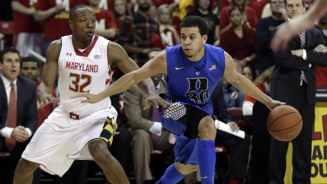 Duke guard Seth Curry, right, drives to the basket past Maryland guard Dez Wells in the first half of an NCAA college basketball game in College Park, Md., Saturday, Feb. 16, 2013. (AP Photo/Patrick Semansky)