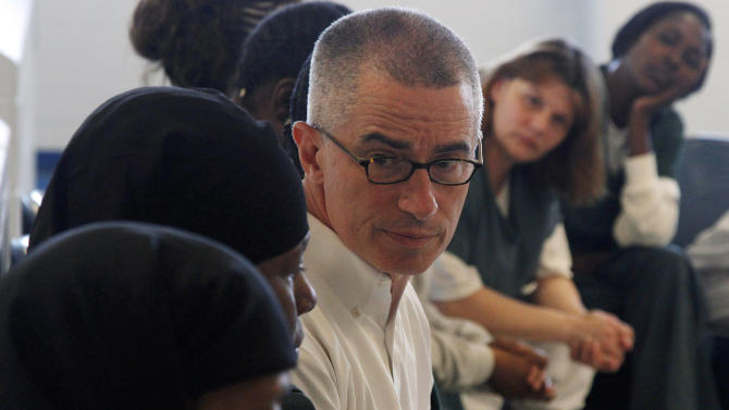 In this photo taken Aug. 2, 201, former New Jersey Gov. James McGreevey, center, listens as an inmate speaks to a gathering of women inmates at Integrity House, a transitional housing/residential treatment area for women incarcerated at the Hudson County Correctional Center in Kearney, N.J. Seven years after coming out as the nation's first openly gay governor and resigning over an affair with a male staffer, McGreevey 54, is the spiritual counselor to 40 women inmates at the North Jersey facility, who have been locked up for crimes ranging from manslaughter and gun possession to drug dealing. (AP Photo/Mel Evans)