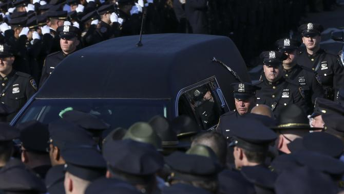 The hearse carrying the casket containing the body of slain New York Police Department (NYPD) officer Rafael Ramos departs the Christ Tabernacle Church to it's final resting place in the Queens borough of New York