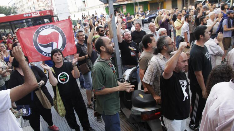 Residents protest as members of the extreme right-wing organisation Espana 2000 march during a demonstration against immigration in the Orriols neighbourhood in Valencia