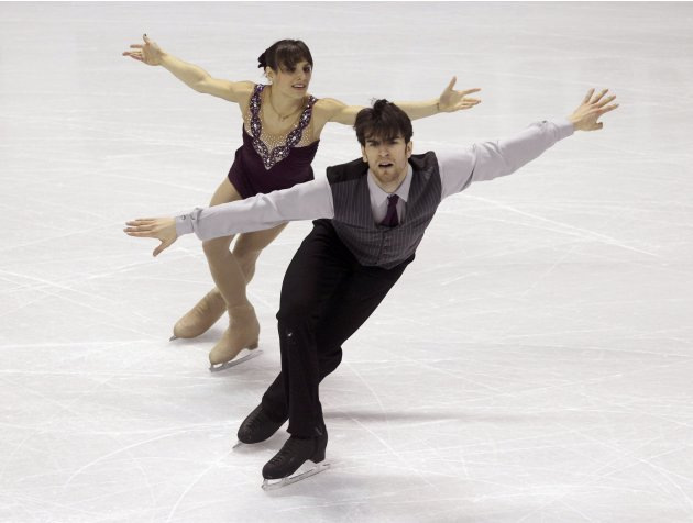 Duhamel and Radford of Canada perform their free skating program at the ISU World Figure Skating Championships in London
