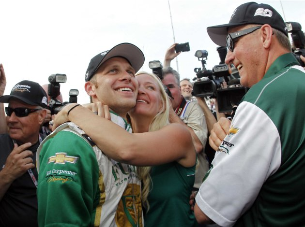 Carpenter of the U.S. celebrates with his wife after taking pole position in the Indianapolis 500 at the Indianapolis Motor Speedway