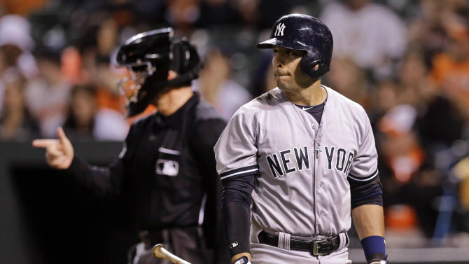 New York Yankees' Martin Prado walks off the field after striking out swinging in the ninth inning of a baseball game against the Baltimore Orioles, Sunday, Sept. 14, 2014, in Baltimore. Baltimore won 3-2. (AP Photo/Patrick Semansky)