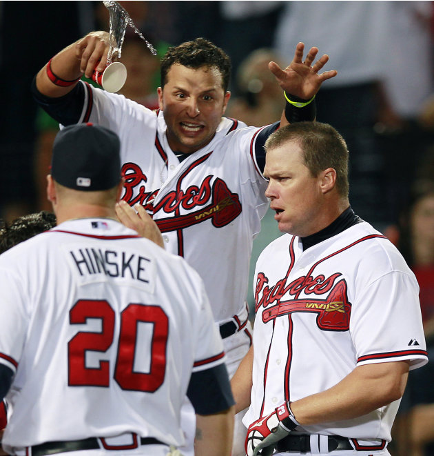 Atlanta Braves' Chipper Jones, right, celebrates with Martin Pardo and Eric Hinske (20) after hitting a game-winning, two-run home run in the 10th inning of a baseball game against the Philadelphia Ph