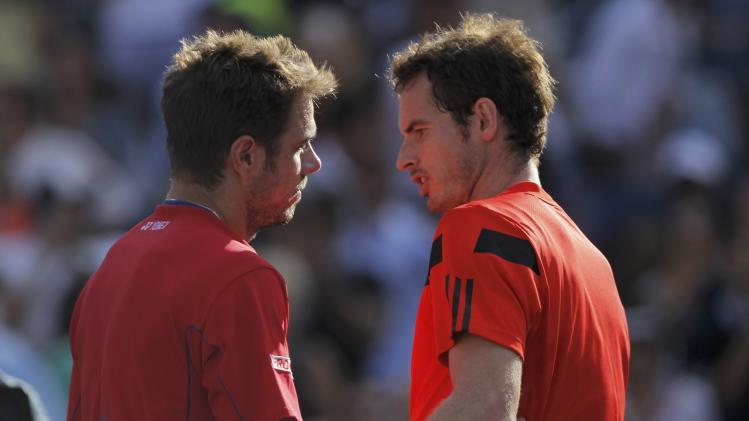 Murray of Britain congratulates Wawrinka of Switzerland after Wawrinka won their match at the U.S. Open tennis championships in New York
